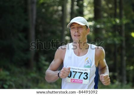KRYNICA-ZDROJ, POLAND - SEPT 11: The runner Piwonski Arkadiusz is running a marathon (control point 39km) at Economic Forum Polish Running Festival September 11, 2011 in Krynica-Zdroj, Poland