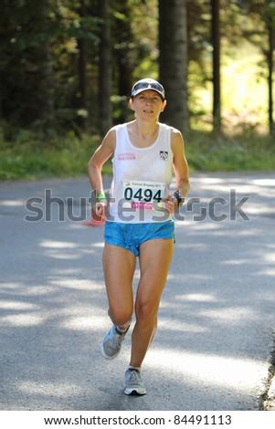 KRYNICA-ZDROJ, POLAND - SEPT 11:The runner Pniak Katarzyna is running a marathon (control point 39km) at Economic Forum Polish Running Festival September 11, 2011 in Krynica-Zdroj, Poland