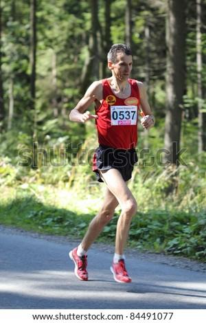 KRYNICA-ZDROJ, POLAND - SEPT 11: The runner Poblocki Piotr is running a marathon (control point 39km) at Economic Forum Polish Running Festival September 11, 2011 in Krynica-Zdroj, Poland