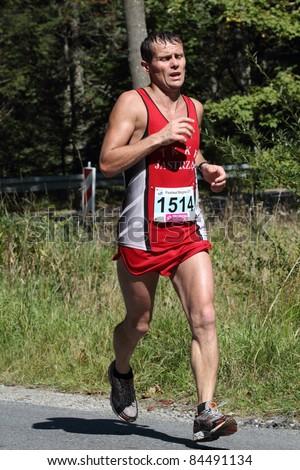 KRYNICA-ZDROJ, POLAND - SEPT 11: The runner Polec Miroslaw is running a marathon (control point 39km) at Economic Forum Polish Running Festival September 11, 2011 in Krynica-Zdroj, Poland