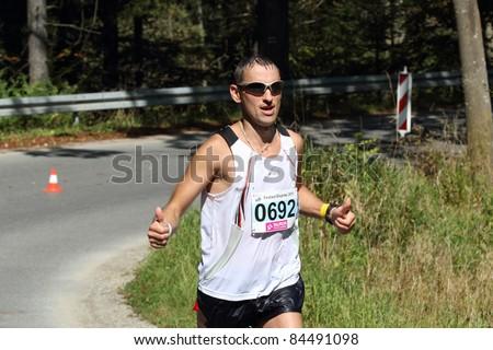 KRYNICA-ZDROJ, POLAND - SEPT 11:The runner Poreba Jacek is running a marathon (control point 39km) at Economic Forum Polish Running Festival September 11, 2011 in Krynica-Zdroj, Poland