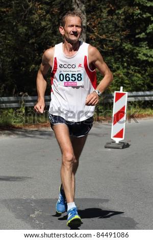 KRYNICA-ZDROJ, POLAND - SEPT 11: The runner Pulik Jerzy is running a marathon (control point 39km) at Economic Forum Polish Running Festival September 11, 2011 in Krynica-Zdroj, Poland