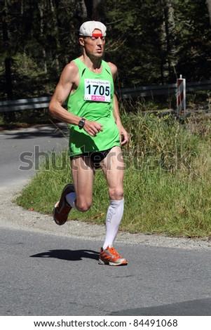 KRYNICA-ZDROJ, POLAND - SEPT 11: The runner Racz Stefan is running a marathon (control point 39km) at Economic Forum Polish Running Festival September 11, 2011 in Krynica-Zdroj, Poland