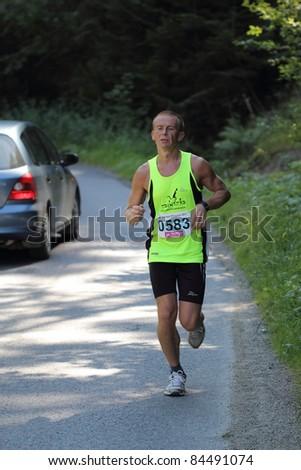 KRYNICA-ZDROJ, POLAND - SEPT 11: The runner Sambak Tadeusz is running a marathon (control point 39km) at Economic Forum Polish Running Festival September 11, 2011 in Krynica-Zdroj, Poland