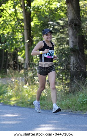 KRYNICA-ZDROJ, POLAND - SEPT 11: The runner Smutek Monika is running a marathon (control point 39km) at Economic Forum Polish Running Festival September 11, 2011 in Krynica-Zdroj, Poland