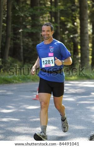 KRYNICA-ZDROJ, POLAND - SEPT 11: The runner Szemler Tamas is running a marathon (control point 39km) at Economic Forum Polish Running Festival September 11, 2011 in Krynica-Zdroj, Poland