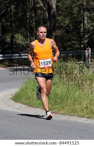 KRYNICA-ZDROJ, POLAND - SEPT 11:The runner Topa Jerzy is running a marathon (control point 39km) at Economic Forum Polish Running Festival September 11, 2011 in Krynica-Zdroj, Poland