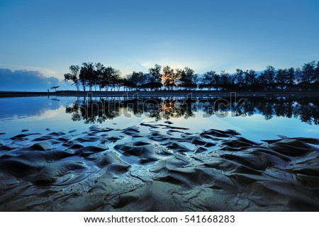 Kuala Ibai Lagoon, Terengganu, Malaysia. Taken during sunrise showing an amazing texture and symmetrical reflections in water. #541668283