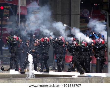KUALA LUMPUR - APRIL 28 - Anti-riot police launches tear gas towards protesters during a public demonstration called Bersih 3.0 on April 28, 2012. Kuala Lumpur