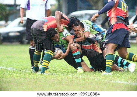 KUALA LUMPUR-APRIL 8: ATM RAMD players blocks an unidentified Keris Conlay player during a Malaysian Rugby Union (MRU) Super League match on April 8, 2012 in Kuala Lumpur, Malaysia. Conlay won 29-12