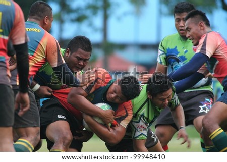 KUALA LUMPUR-APRIL 8:ATM RAMD players defend the ball possession during a Malaysian Rugby Union(MRU) Super League match against Keris Conlay on April 8,2012 in Kuala Lumpur, Malaysia. Conlay won 29-12