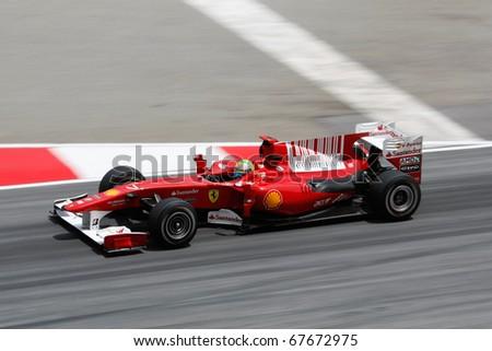 KUALA LUMPUR - APRIL 2: Ferrari's Felipe Massa takes to the tracks on practice day at the 2010 Petronas Malaysia F1 Grand-Prix on April 2, 2010 in Sepang, Malaysia.