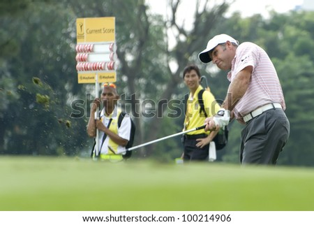 KUALA LUMPUR - APRIL 14: Hennie Otto of South Africa hits a shot on to 13rd green during 3rd round of Maybank Malaysian Open 2012 at Kuala Lumpur Golf & Country Club on April 14, 2012 in Kuala Lumpur.