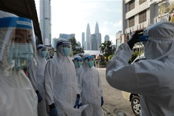 Kuala Lumpur,30 April 2020-Malaysia. A Malaysian medical workers wearing personal protective equipment before conduct a covid 19 test in Kuala Lumpur.