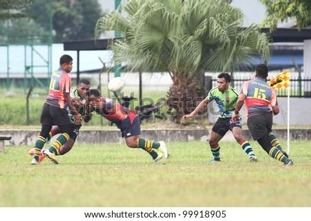 KUALA LUMPUR-APRIL 8: Players compete for the ball possession a MRU Super League match between Keris Conlay(green jersey) and ATM RAMD  on April 8, 2012 in Kuala Lumpur, Malaysia. Conlay won 29-12