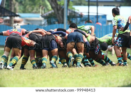 KUALA LUMPUR-APRIL 8: Players form a scrum during a Malaysian Rugby Union(MRU) Super League match between Keris Conlay and ATM RAMD on April 8, 2012 in Kuala Lumpur, Malaysia. Conlay won 29-12
