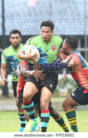 KUALA LUMPUR-APRIL 8: Two ATM RAMD players blocks an unidentified  Keris Conlay player during a Malaysian Rugby Union(MRU) Super League match on April 8, 2012 in Kuala Lumpur.Malaysia.Conlay won 29-12