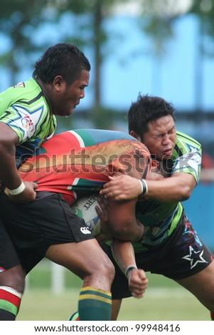 KUALA LUMPUR-APRIL 8: Two unidentified Keris Conlay player block an ATM RAMD player during a Malaysian Rugby Union(MRU) Super League match on April 8, 2012 in Kuala Lumpur, Malaysia. Conlay won 29-12