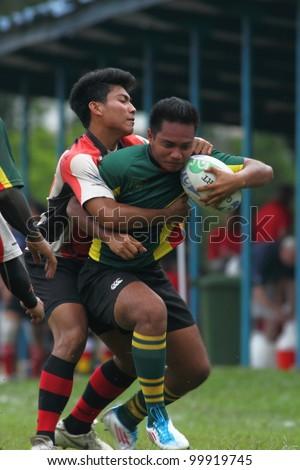KUALA LUMPUR - APRIL 1 : Unidentified ASAS player blocks a ATM RAMD player during a Malaysian Rugby Union(MRU) Super League match on April 1, 2012 in Kuala Lumpur, Malaysia. ASAS won 27-25