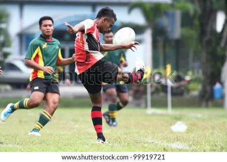 KUALA LUMPUR - APRIL 1: Unidentified ASAS player kick the ball during a Malaysian Rugby Union (MRU) Super League match againts ATM RAMD on April 1, 2012 in Kuala Lumpur, Malaysia. ASAS won 27-25