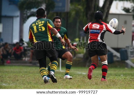 KUALA LUMPUR - APRIL 1:Unidentified ASAS player passes the ball during a Malaysian Rugby Union(MRU) Super League match against ATM RAMD on April 1, 2012 in Kuala Lumpur, Malaysia. ASAS won 27-25