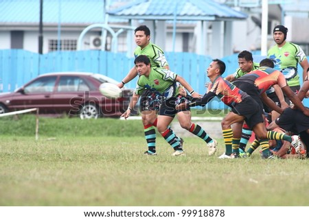 KUALA LUMPUR-APRIL 8:Unidentified ATM RAMD player passes the ball during a Malaysian Rugby Union(MRU) Super League match against Keris Conlay on April 8,2012 in Kuala Lumpur,Malaysia. Conlay won 29-12