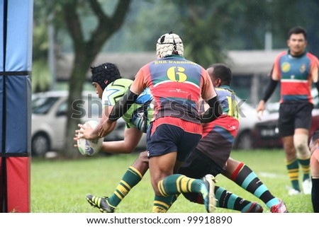 KUALA LUMPUR-APRIL 8:Unidentified Keris Conlay player attempt a try during a Malaysian Rugby Union (MRU) Super League match against ATM RAMD on April 8,2012 in Kuala Lumpur, Malaysia. Conlay won 29-12