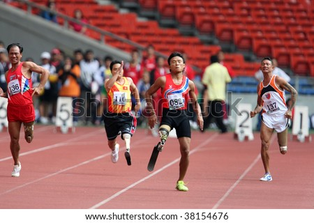 KUALA LUMPUR - AUGUST 15: Amputees run the 100m race at the track and field event of the fifth ASEAN Para Games on August 15, 2009 in Kuala Lumpur, Malaysia.