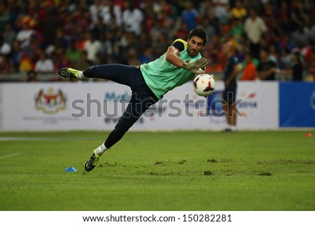 KUALA LUMPUR - AUGUST 9: FC Barcelona goal keeper Oier Olazabal dives during training at the Bukit Jalil National Stadium on August 09, 2013 in Malaysia. FC Barcelona is on an Asia Tour to Malaysia.