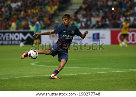 KUALA LUMPUR - AUGUST 10: FC Barcelona 's Neymar Jr. controls the ball during warm-up before the game against Malaysia at the Shah Alam Stadium on August 10, 2013 in Malaysia. FC Barcelona wins 3-1.