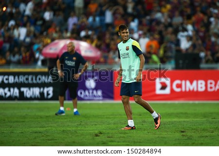 KUALA LUMPUR - AUGUST 9: FC Barcelona's Neymar Junior reacts during training at the Bukit Jalil Stadium on August 09, 2013 in Malaysia. FC Barcelona is on an Asia Tour to Malaysia.