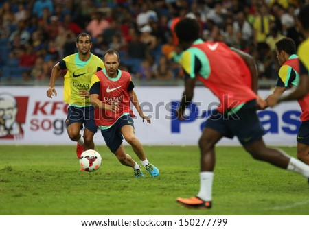 KUALA LUMPUR - AUGUST 9: FC Barcelona 's players practice during training at the Bukit Jalil National Stadium on August 09, 2013 in Malaysia. FC Barcelona is on an Asia Tour to Malaysia and Thailand.