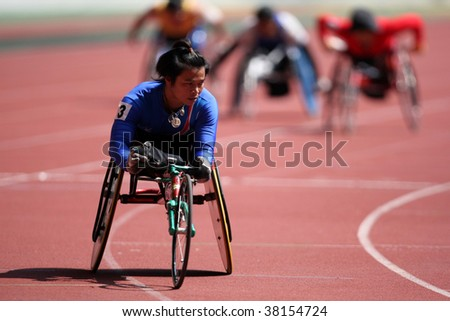 KUALA LUMPUR - AUGUST 16: Thailand's wheel chair athlete wins the 800m race at the track and field event of the fifth ASEAN Para Games on August 16, 2009 in Kuala Lumpur.