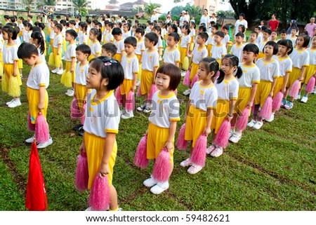 KUALA LUMPUR - AUGUST 15 : Unidentified kids singing national anthem at Taman Midah Kindergarten sport day, on August 15, 2010 in Kuala Lumpur Malaysia.