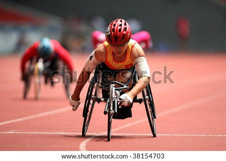 KUALA LUMPUR - AUGUST 15: Vietnam's wheel chair athlete leads the 800m race at the track and field event of the fifth ASEAN Para Games on August 15, 2009 in Kuala Lumpur.