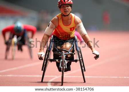 KUALA LUMPUR - AUGUST 15: Vietnam's wheel chair athlete wins the 800m race at the track and field event of the fifth ASEAN Para Games on August 15, 2009 in Kuala Lumpur. - stock photo