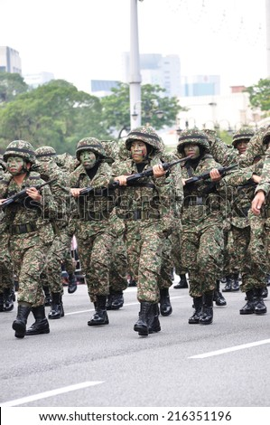 KUALA LUMPUR - AUGUST 31: Women infantry soldiers from the Malaysian Armed Forces march during Malaysia\'s Independence Day parade on August 31, 2014 in Kuala Lumpur, Malaysia.