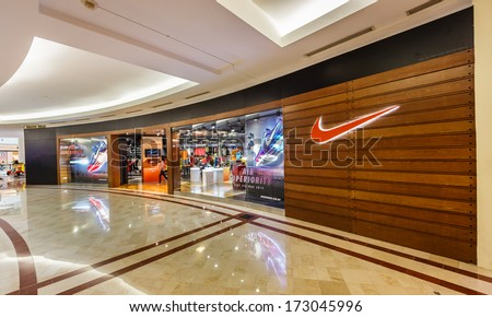 KUALA LUMPUR DEC 23 Nike shop at KLCC on Dec 23 13 in KL It is an American company engaged in the design development manufacturing and marketing of footwear apparel equipment and services
