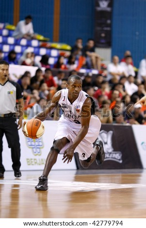 KUALA LUMPUR - DECEMBER 13: KL Dragons' Chris Kuete in a fast break in this match against Thailand Tigers in the ASEAN Basketball League match December 13, 2009 in Kuala Lumpur.