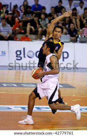 KUALA LUMPUR - DECEMBER 13: KL Dragons' Guganeswaran runs in for a lay-up against Thailand Tigers in the ASEAN Basketball League match December 13, 2009 in Kuala Lumpur.