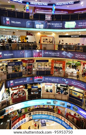 KUALA LUMPUR - FEBRUARY 22: Interior view of Low Yat Plaza on February 22, 2012 in Kuala Lumpur, Malaysia. Low Yat Plaza is a modern hi-tech shopping mall specializing in electronic products