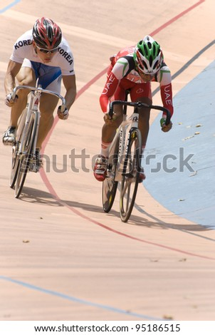 KUALA LUMPUR - FEBRUARY 9: Rider from Korea (left) competed with rider from UAE (right) during Asian Cycling Championships 2012 held in Kuala Lumpur, Malaysia on February 9, 2012.