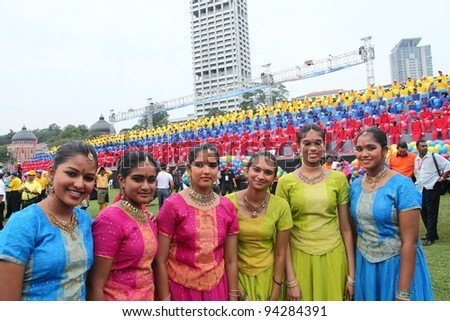 KUALA LUMPUR - JAN 28: A group of beautiful Indian ladies participate in the Federal Territory Day celebration on Jan 28, 2012 in Dataran Merdeka, Kuala Lumpur, Malaysia