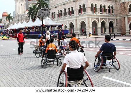 KUALA LUMPUR - JAN 29: Disable group compete in basketball competition during the Federal Territory Day celebration on Jan 29, 2012 in Dataran Merdeka, Kuala Lumpur, Malaysia