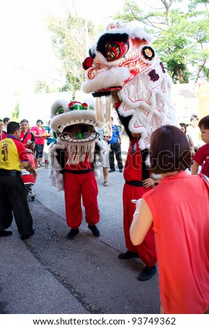 KUALA LUMPUR-JAN 24: Malaysian Traditional Lion Dance performs a dance routine  outside the Thean Hou Temple during Chinese New Year celebrations on January 24, 2012 in Kuala Lumpur, Malaysia.