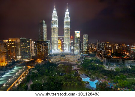 KUALA LUMPUR-JAN-23-2012: View of The Petronas Twin Towers at night on January 23, 2012 in Kuala Lumpur, Malaysia. Petronas are the tallest twin buildings in the world (451.9 m)