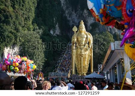 KUALA LUMPUR - JANUARY 27: Hindu devotees carry 'kavadi' as offering to Lord Muruga walk up the steps of Batu Caves temple on January 27, 2013 during the Thaipusam festival in Kuala Lumpur, Malaysia.