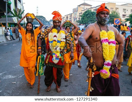 KUALA LUMPUR - JANUARY 27:Hindu devotees perform various acts of devotion to Lord Muruga while walking to the Batu Caves temple on January 27, 2013 at the Thaipusam festival in Kuala Lumpur, Malaysia.