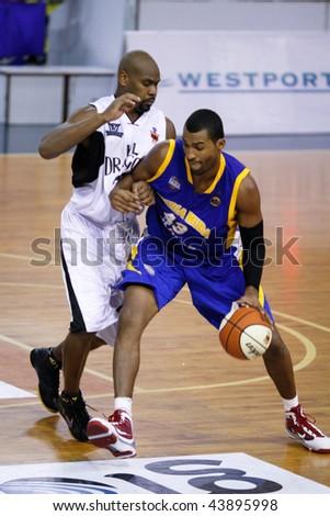 KUALA LUMPUR - JANUARY 05: KL Dragons' Jamal Brown defends Satria Muda BritAma's Nakiea Miller at the ASEAN Basketball League match January 05, 2010 in Kuala Lumpur.