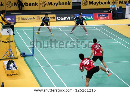 KUALA LUMPUR - JANUARY 15: Malaysia's Chan/Ong (blue) play against Indonesia's Wirawan/Septano at the Maybank Malaysia Open 2013 Badminton event on January 15, 2013 in Kuala Lumpur, Malaysia.
